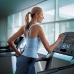 girl running on treadmill at gym