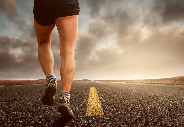 A pro runner is running on road