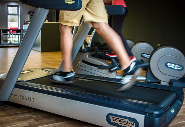 Man running in the treadmill at home